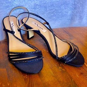 Navy blue sling back dress shoes.